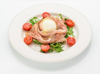 Buffalo mozzarella and prosciutto salad. Isolated.