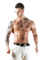 Sexy muscular fitness model with tattooed torso
