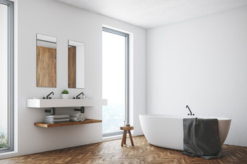 White bathroom, white tub, corner