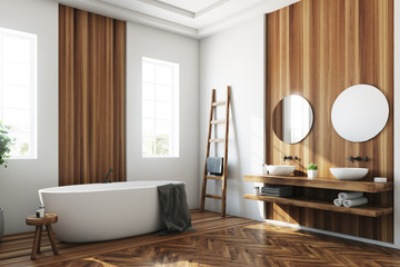 White and wooden bathroom, white tub side
