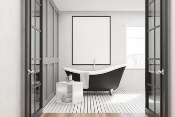 White bathroom, black tub, poster