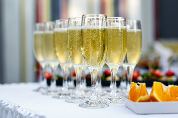Champagne glasses being served on a party.