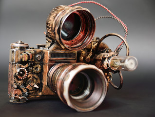 futuristic steampunk camera on a dark background close up