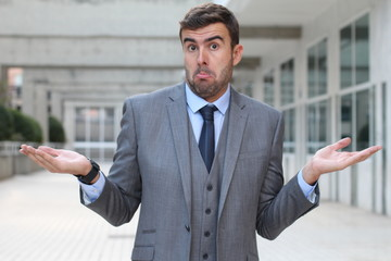 """Businessman with """"I have no idea"""" expression"""