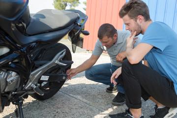 men with motorbike