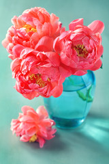 Beautiful bouquet of flowers.Close-up floral composition with a peonies . Close-up floral composition with a pink peonies on a green background.