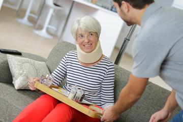 senior lady having food in nursing home