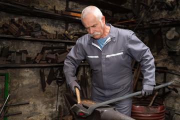 senior tinsmith in his workshop