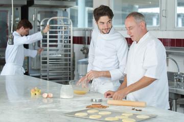 male chef preparing cake