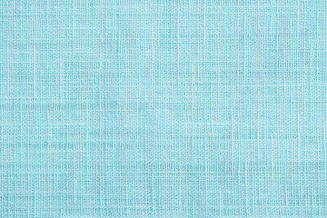Jute hessian sackcloth canvas sack cloth woven texture pattern background in teal cyan blue color