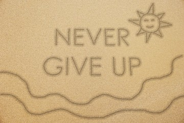 never give up word with smiling sun and wave on fine sand