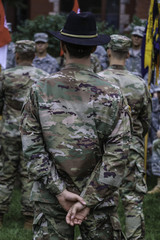 Commander standing from of soldiers