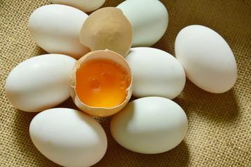 yolk in crack brown egg on sackcloth