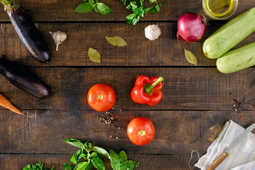 Different vegetables on dark wooden table, top view