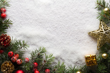 Christmas background with decorations and gift box on snow