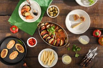 Different vegetarian food. Ratatouille, chickpeas cutlets, lemonade and various snacks