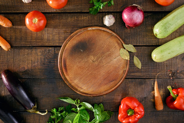Raw ingredients for cooking ratatouille on wooden table, top view
