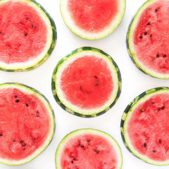 Pattern of watermelon lobules. Fresh watermelon, sliced in circles on a white background.