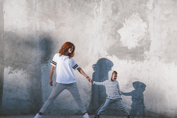 Family fashion casual outfit for mom and kid Wall mural