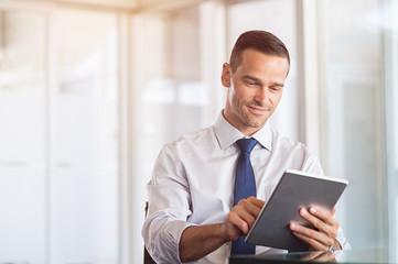 Businessman working on digital tablet