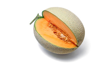 Orange Melon fruit cut to show flesh and seeds on white background.
