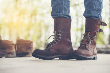 A Man Wear a Brown Boots and Jeans
