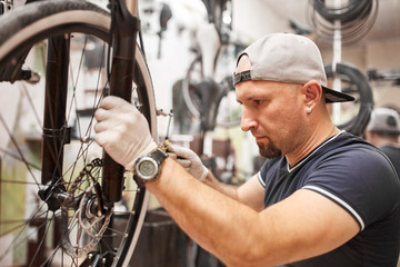 Mechanic repairing a mountain bike in a workshop