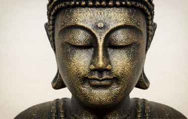 Papiers peints Buddha Siddhartha bronze statue. Close up of Buddha beautiful serene face with closed eyes. Best meditation inspiration image or mindfulness background.