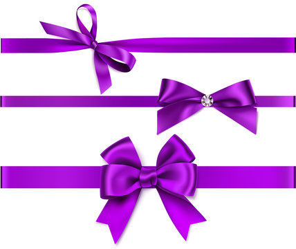 Set of decorative purple bow with horizontal purple  ribbon isolated on white