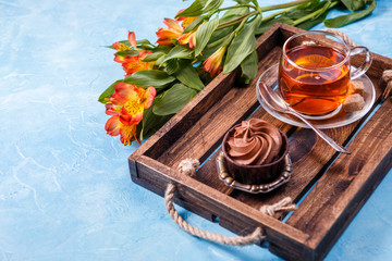 Photo of breakfast with cupcake, orange flowers