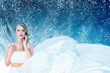 Winter fantasy fashion portrait of young woman
