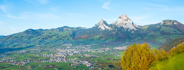 Alps of Central Switzerland.  Autumn day. Panorama of Canton Schwyz from  Morsch. Mountain peaks Mythen ( Grosse Mythe) is a mountain in the Schwyzer Alps of Central Switzerland.  Autumn day.