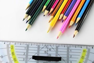 An image of a triangle ruler and a pen - office, school