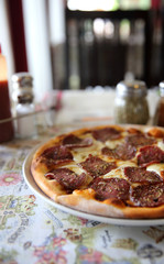 Pepperoni pizza , pizza with pepperoni mozzarella cheese and tomatoes with sauce background italian food