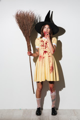 Full length image of serious pensive woman in halloween costume