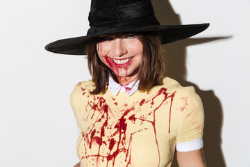 Close up image of smiling woman in halloween costume