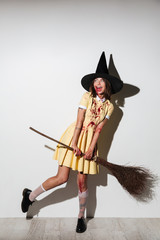 Full length image of crazy woman in halloween costume