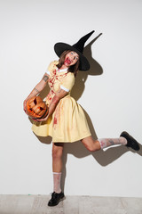 Full length image of Screaming mad woman in halloween costume