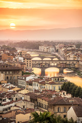 Photo sur Plexiglas Cappuccino Aerial view of Florence at sunset with the Ponte Vecchio and the Arno river, Tuscany, Italy