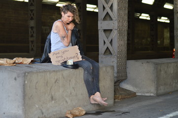 alcohol addicted, homeless woman begging for money holding a sign - are you my neighbor?