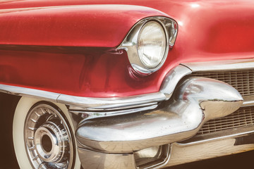 Front view of a red fifties American car