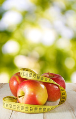 image of apple and centimeter on the table