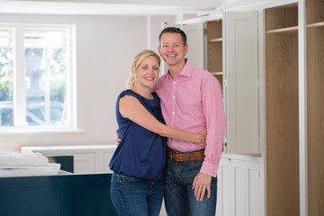 Portrait Of Mature Couple At Home As New Luxury Kitchen Is Fitted