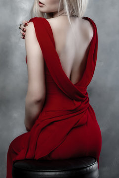 back woman in red dress