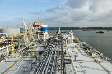 Crude oil tanker discharging to the terminal.