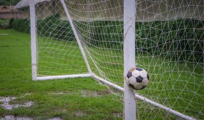 Football stucked in the net