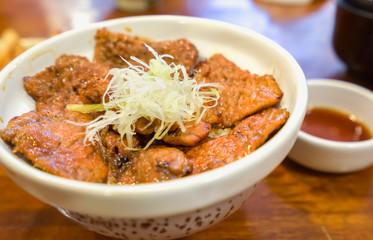 Buta-don,Japanese cuisine or Pork rice bowl. Selective depth of field.
