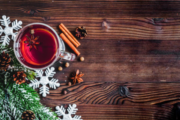 cup with christmas mulled wine on wooden background top view