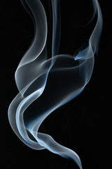 Smoke on a black, abstract background.
