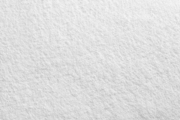 Bright white powder closeup macro texture pattern.